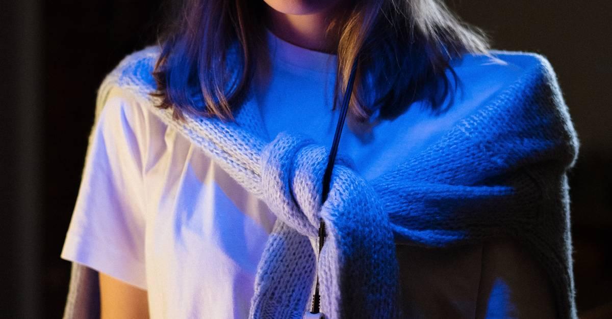 A woman wearing a blue shirt